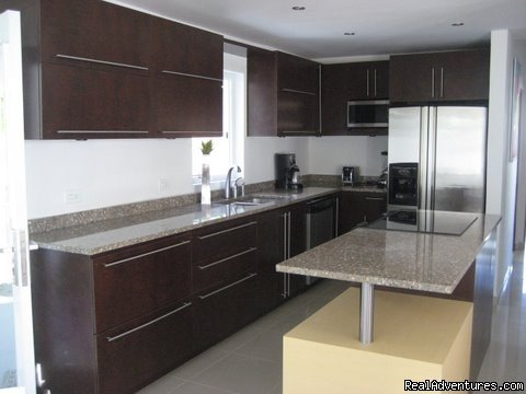 Granite Covered Kitchen with Stainless Steel Appliances