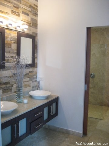 Master Bath with double vanity and marble enclosed rainshowe - Ocean Villa 2 blocks from the beach in San Juan