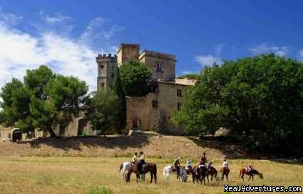 Riders in front of the Lourmarin's Castle - Cap Rando - Horseback Riding Vacations In Provence
