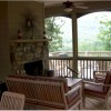 Screened Porch with seating for everyone next to woods