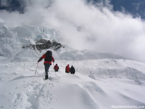 trekking and mountaineering in Sikkim India climbers proceeding towards Mt. Thingchinkhang 6101 mtrs
