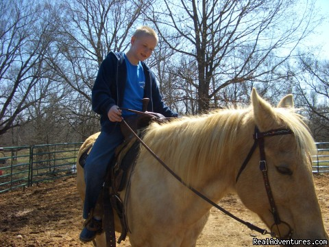 Tyler is enjoying horseback riding - Golfing Getaway at Cart Barn Inn @ Yoda Creek