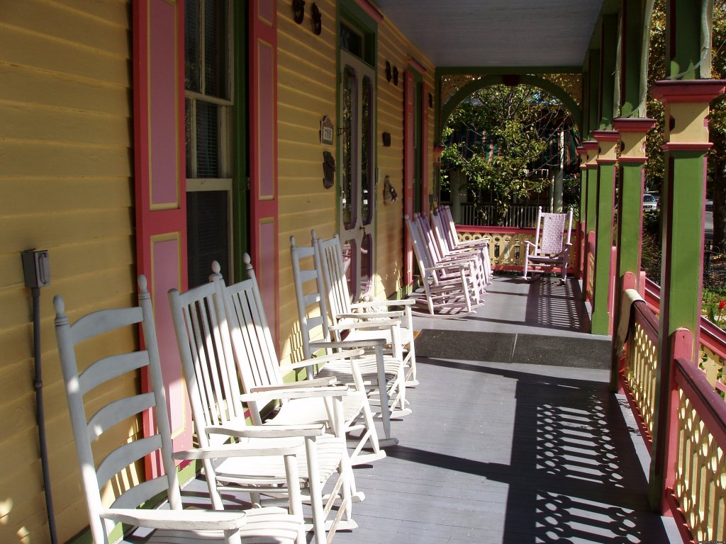 The front portion of the expansive porch | Image #2/7 | Rent a Victorian B&B, 2 blocks to the beach