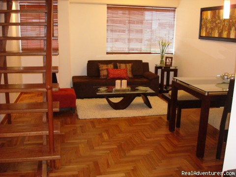 Living Room - NEW 2 bd 3 bth duplex just behind the JW Marriott