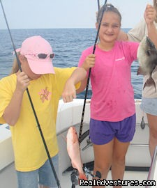 Girls having fun and fishing in Gulf Shores - Gulf Shores fishing on your family vacation