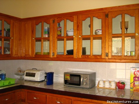 Kitchen area with cupboard and counter top - Rich View Hotel