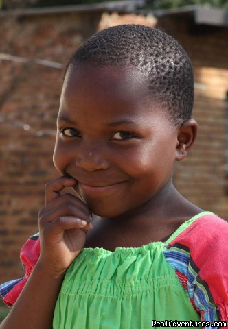 happy girl - Mufasa backpackers,tours, and orphanage program