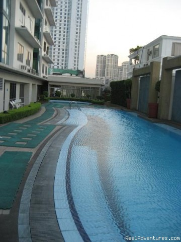Ortigas Center 1-BR Hotel Condo Suite: Hotel's outdoor lap pool