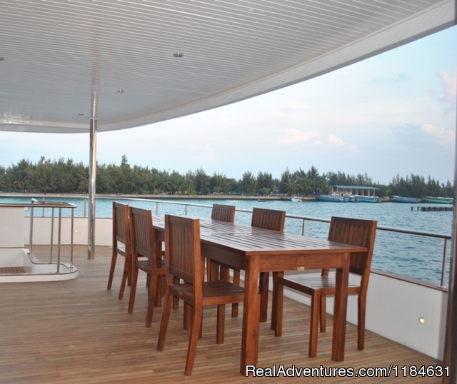 Maldives cruising with BBQ lunch on picnic island Bridge Deck Dining