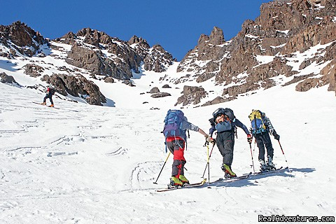 Bracing against the snow storm in the High Atlas, Morocco - Skiing Touring  In Toubkal And M'goun