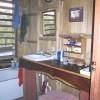 7'x9' bathroom with double sinks + slant-backed tub