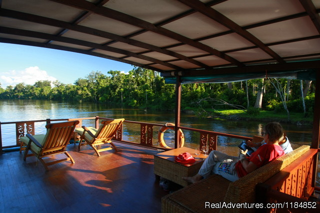 The comfortable viewing deck of the Rahai'i Pangun II - Relax on a Jungle River Journey in Borneo