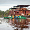 Relax on a Jungle River Journey in Borneo Guests relaxing on the deck of the Rahai'i Pangun