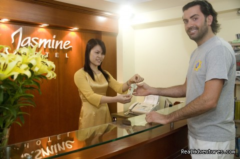 Receptionist and a guest at Jasmine Garden Hotel - Jasmine Garden Hotel-Hanoi Old Quarter