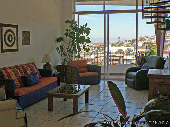 Unit 1 Living Room w/spiral staircase to rooftop terrace - 2+ bdrm condo in the Romantic Zone