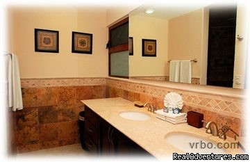 master bathrooom with travertine marble - Beachfront Penthouse in Town with Infinity Pool