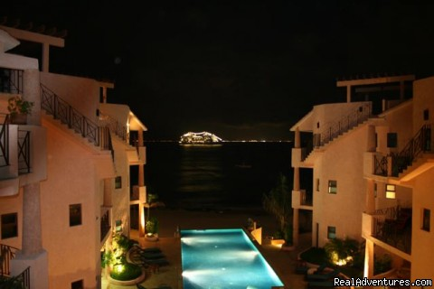 cruiseship at night - Beachfront Penthouse in Town with Infinity Pool