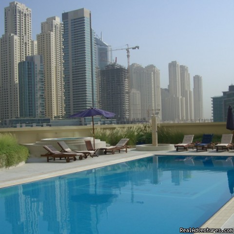 Pool with view of Marina and Yacht Club - Corner 1-bed apartment sea/Marina view in Dubai