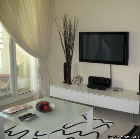 Living room showing entertainment system - Corner 1-bed apartment sea/Marina view in Dubai