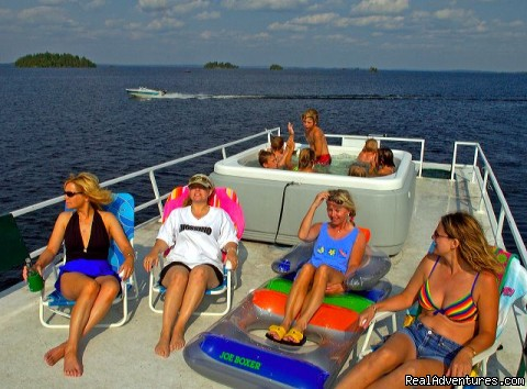 Enjoying the sun and fun on a Rainy Lake Houseboat cruise - Rainy Lake Houseboats  premier houseboat rentals