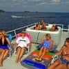 Enjoying the sun and fun on a Rainy Lake Houseboat cruise