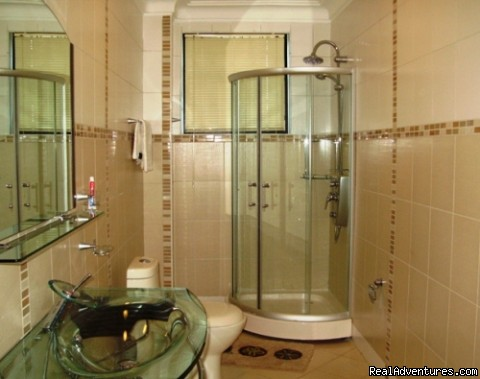 Power shower-kampala apartments - Kampala furnished apartments & Uganda car hire 4x4