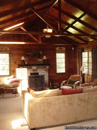 large livingroom with wood burning stove - Summerland Cabin Russian River