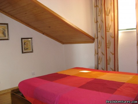 Bedroom with double bed - More Holidays Less Money with Alis Ubbo Apartments