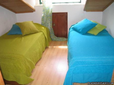 Bedroom with two single beds - More Holidays Less Money with Alis Ubbo Apartments