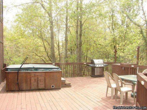 side of deck with grill, hot tub and table | Image #18/21 | Charming Chalet with HUGE Deck
