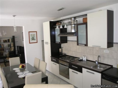 Kitchen - Lux apartment with private garden close the beach