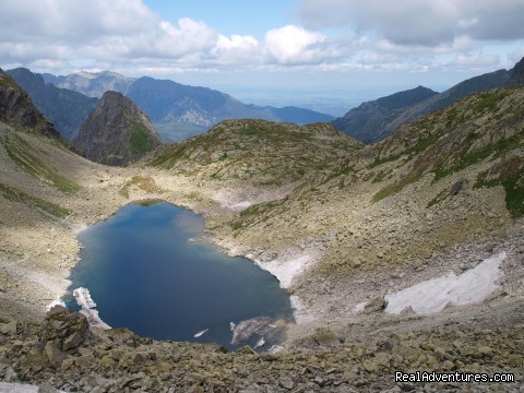Adventure Hiking & Trekking in Slovakia: Frozen mountain lake in the High Tatras