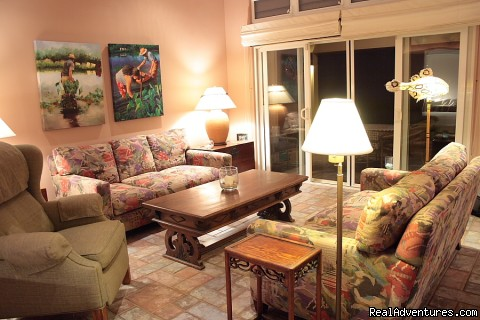living room in the evening - Wailele Ocean Front Beach Home-Maui