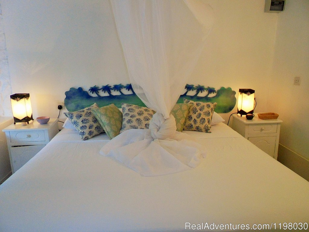 Blue Bamboo Bedroom | Image #2/26 | Mango Beach Inn, Adventure Lodge