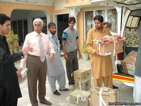 KariM Meghji supervising medicine uploads for IDPs by CDRS | Image #25/25 | NewCapeGrace Guest House,Hotels IslamabaD Pakistan