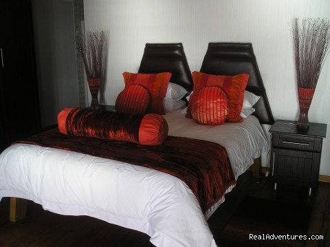 Experience an African sunrise at Vista Alta. Orange Room.