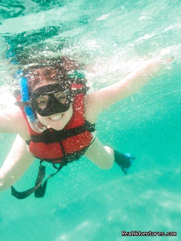 Snorkeling in the crystal clear waters of Tunnels - All Inclusive Womens Retreats - Hanalei Bay, Kauai