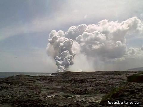 Madam Pele spewing into the ocean (#4 of 4) - Amazing Volcano Big Island Tours