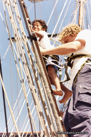 Professional crew take guests up the rigging - Nicholson Yachts