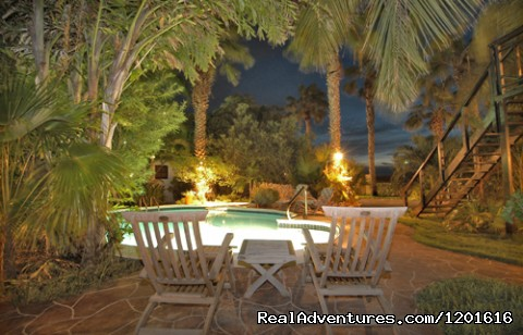 Poolview at night - Boardwalk Vacation Retreat Aruba