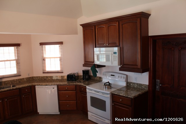 Spacious fully equipped kitchen - Home away from Home at ClearView Suites & Villas
