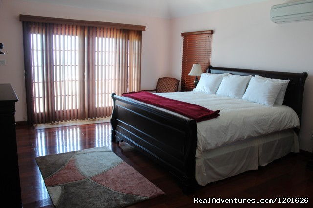 Bedroom 1 with King Bed (#3 of 14) - Home away from Home at ClearView Suites & Villas