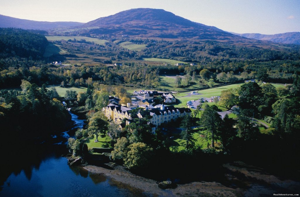 One of Ireland's finest hotels, stunning views of Kenmare Bay, cascading waterfalls,  ideal for touring the South West of Ireland.  Traditional hunting lodge in 300 acre estate with seven thatched cottages for rental.