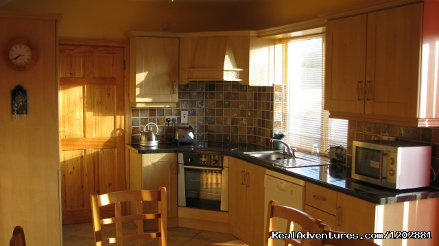 Riverside self-catering kitchen - Riverside Self Catering. Ideal for fishing holiday