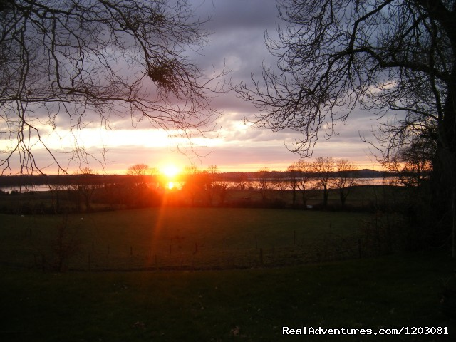 Sunset over Lough Owel lake - Relax, unwind on our organic farm Lough Owel Lodge