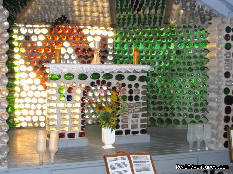 Altar in glass chapel (#2 of 11) - The Bottle Houses/Maisons de Bouteilles