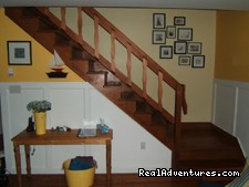 Well appointed and spotlessly clean beach house...: Fair Wind staircase to second level great room and balcony