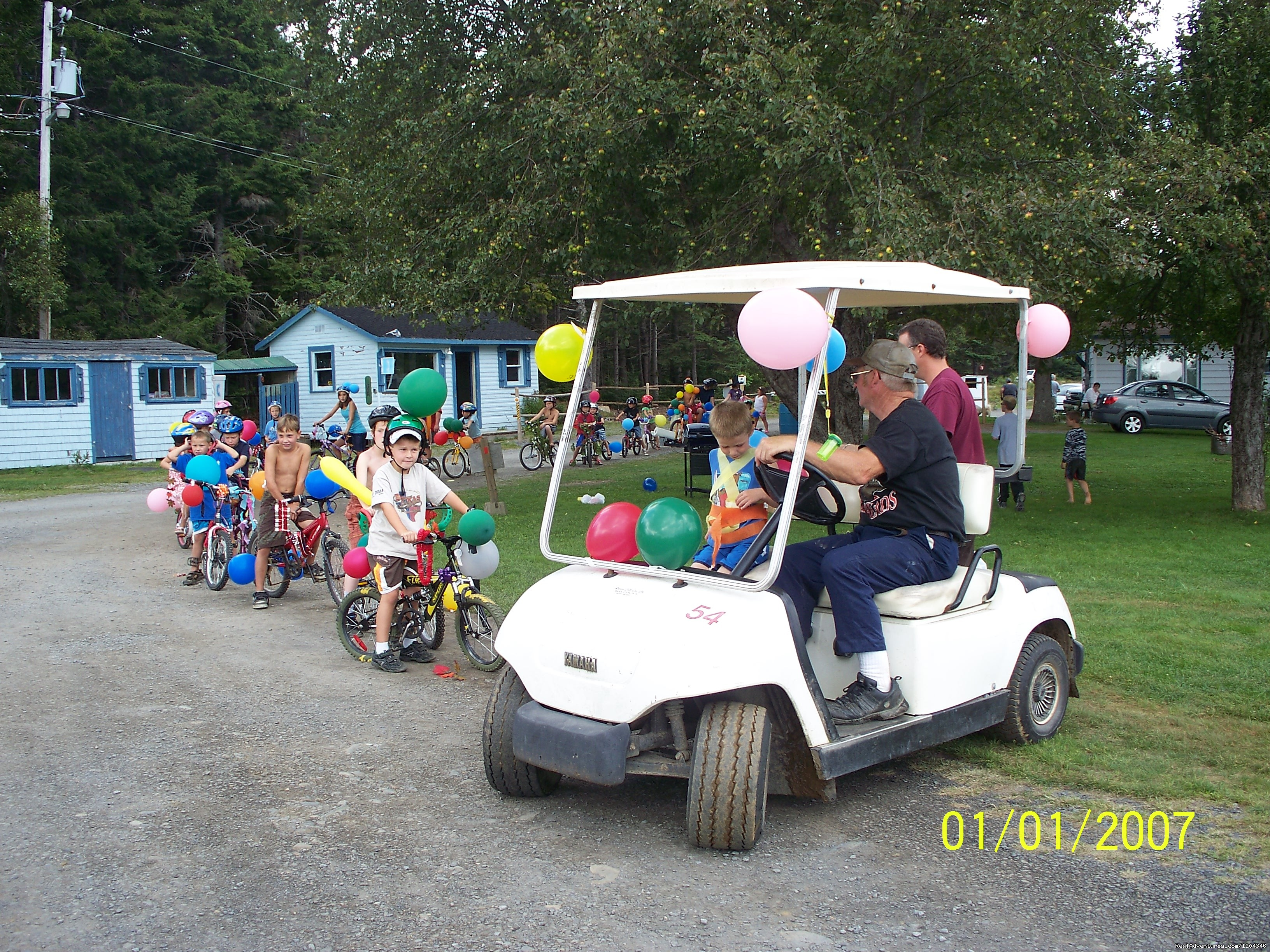 owner leading the kids bike parade | Image #10/11 | Little Lake Family Campground