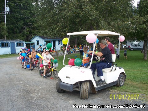 owner leading the kids bike parade - Little Lake Family Campground