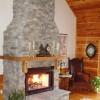 Soaring fieldstone fireplace